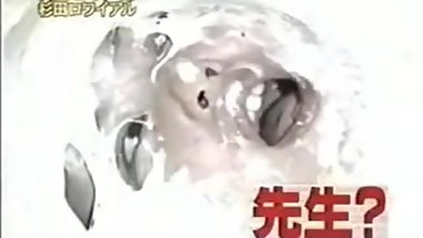 Thick white gunge poured on Japanese woman's face