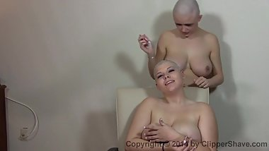 two beautiful girls shave each other
