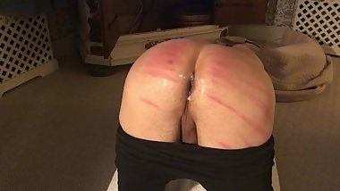 Caning, black dildo and fisting