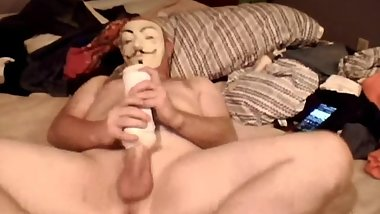 Hung dude in a mask fucks toys