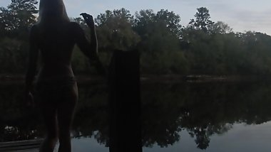 risky public sunset topless striptease over dock on river