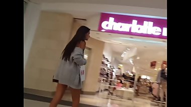 Candid voyeur long leg teen shopping in tiny shorts