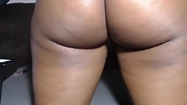 Sexy black girl shows off her perfect ass, twerks, and plays with her pussy