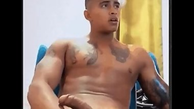 Cute Latino shows his curved cock