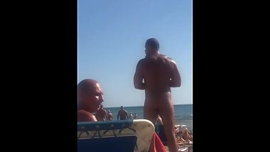 Hung guy in gay nude beach