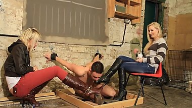 2 sexy blonde goddesses in boots use their slave
