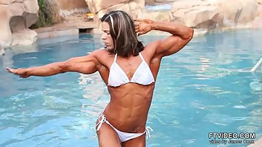 Muscular woman in pool
