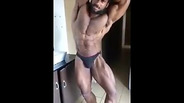 Dark Indian Hunk Flexes muscles